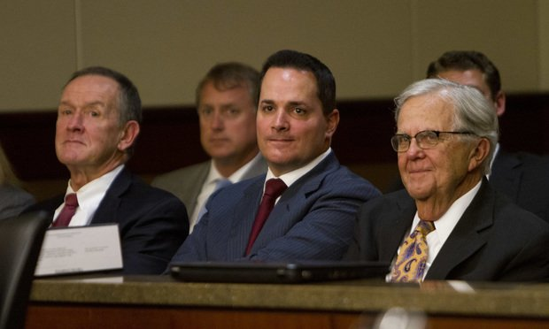 The lawyers being sued for alleged extortion watch the proceedings. From left, they are John Butters, David Cohen and Hylton Dupree Jr.
