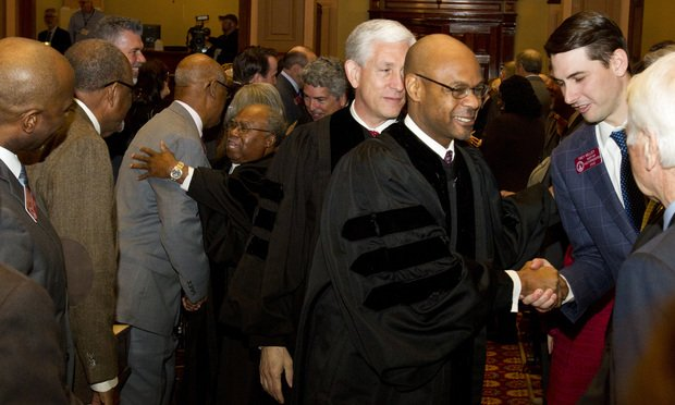 Georgia Supreme Court Chief Justice Harold Melton, follwed by Presiding Justice David Nahmias and Justice Robert Benham along with the other justices are greeted by Georgia lawmakers before Melton delivered the State of the Judiciary. (Photo: John Disney/ALM)