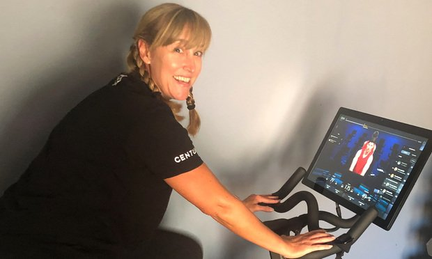 Barbara A. Marschalk, a Drew Eckl Farnham partner, doing her workout on a Peloton bike. (Courtesy photo)