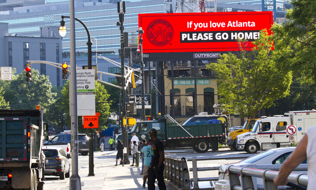 A billboard outside CNN Center in Atlanta after a night of violent protests and riots on May 29. (Photo: John Disney/ALM)