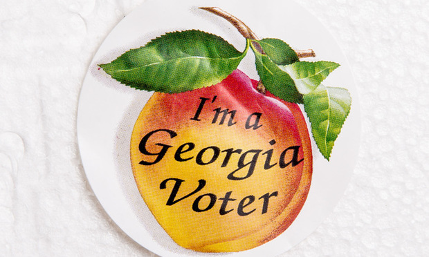 A peach-shaped sticker given to Georgia voters.
