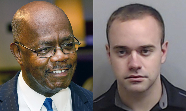 Fulton County District Attorney Paul Howard and Atlanta police officerRolfe Garrett.