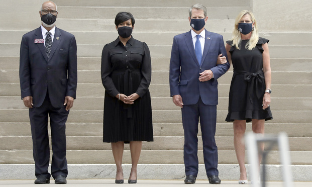 Georgia Gov. Brian Kemp, second from right, his wife Marty Kemp, right, and Atlanta Mayor Keisha Lance Bottoms, second from left, await the casket of Rep. John Lewis at the state capital, Wednesday, July 29, 2020, in Atlanta. Lewis, who carried the struggle against racial discrimination from Southern battlegrounds of the 1960s to the halls of Congress, died Friday, July 17, 2020. (AP Photo/Brynn Anderson)