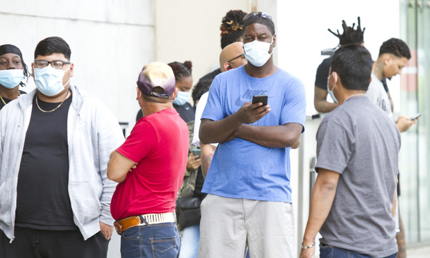 Hundreds of customers wait outside a Nike Store in Atlanta Georgia on Friday May 15th 2020. There was no social distancing and many patrons did not have masks on.