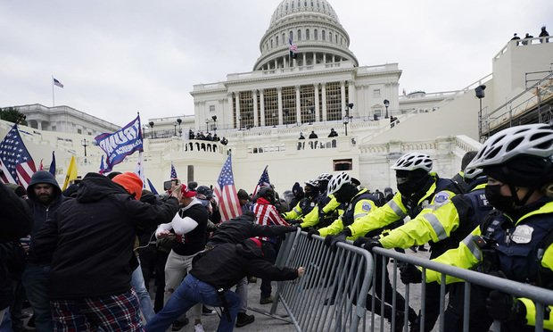 Trump supporters try to break through a police barrier at the Capitol in Washington on Jan. 6, 2021.