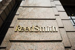 Reed Smith Partially Walks Back Pay Cuts for Lawyers Staff