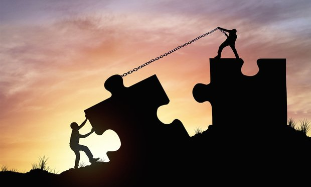 merger stock art: puzzle pieces