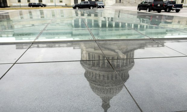 The U.S. Capitol Rotunda is reflected outside in Washington, D.C., on Wednesday, February 27, 2019.