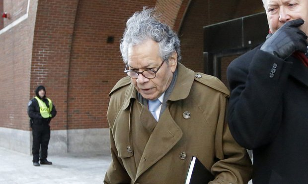 Insys Therapeutics founder John Kapoor, center, departs federal court in Boston, Wednesday, Jan. 30, 2019. (AP Photo/Steven Senne)