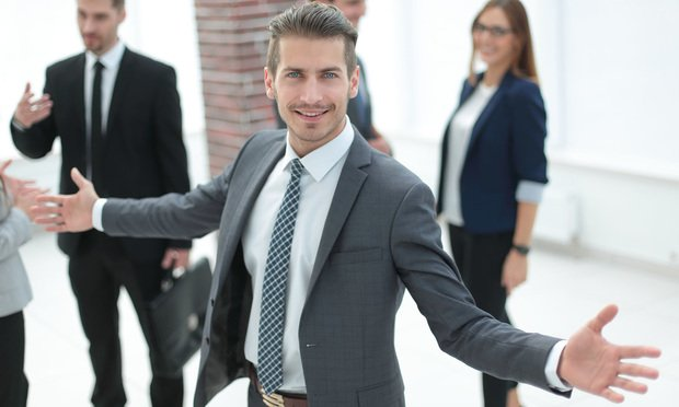 Guy in suit with open arms.