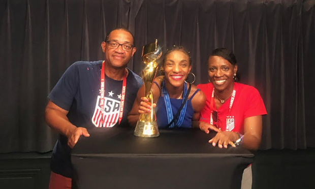 U.S. Women's National Team defender Crystal Dunn in a photo with her parents, Vincent Dunn and Rhonda Dunn.