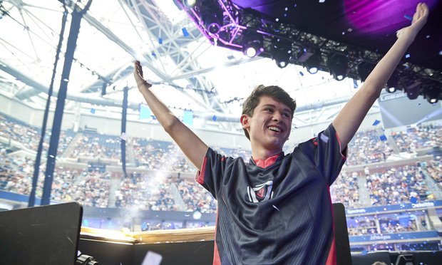 "In this July 28, 2019, photo provided by Epic games, Kyle Giersdorf reacts after he won the Fortnite World Cup solo finals in New York. Giersdorf, of Pottsgrove, Pa. who goes by the name ""Bugha"" when competing, racked up the most points and won $3 million as the first Fortnite World Cup solo champion. (Epic Games via AP)"