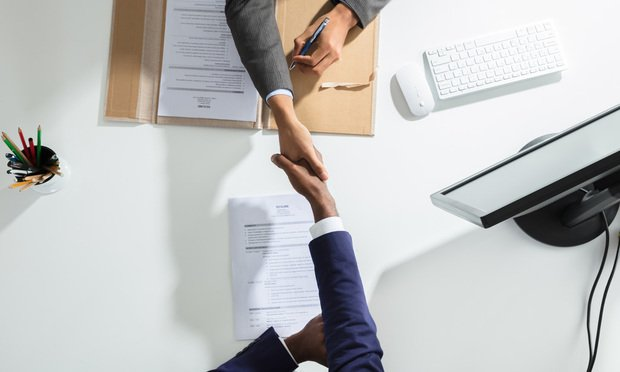 Shaking Hand with Candidate for interview.