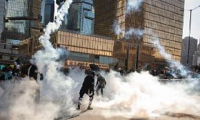 Law Firm Staffer Tear Gassed in Hong Kong as Debate Intensifies on How Firms Are Protecting Staff