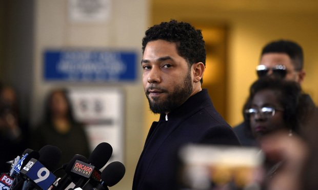<i>Actor Jussie Smollett talks to the media before leaving Cook County Court after his charges were dropped, in Chicago. (AP Photo/Paul Beaty, File)</i>