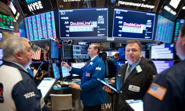 Traders on the floor of the New York Stock Exchange (NYSE) in New York, U.S., on Wednesday, February 26, 2020, as a global stock market slide continued.