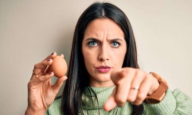 Woman with egg.