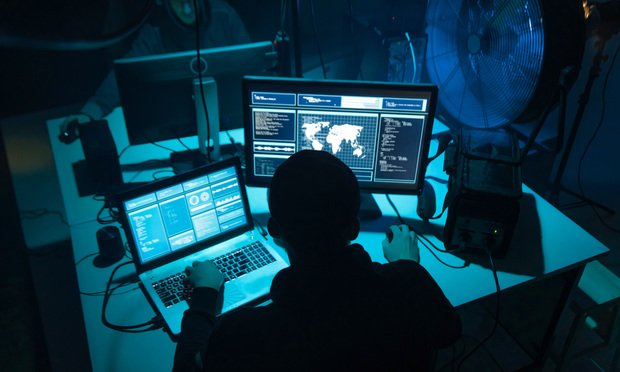 Photo illustration of hackers coding.