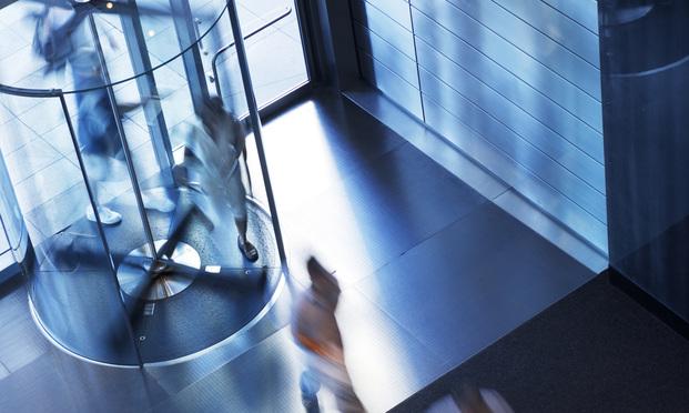 People going through a revolving door