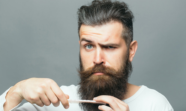 man combing long beard