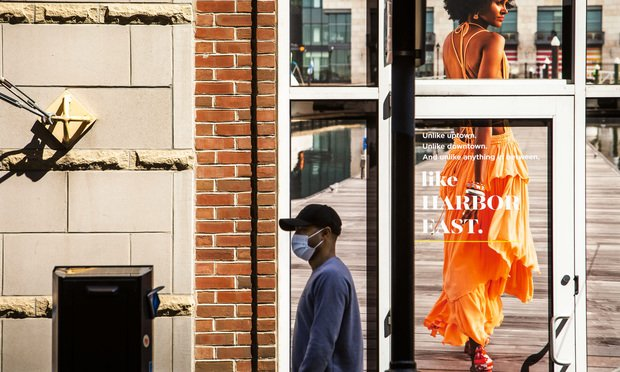 A man wears a protective mask during the Coronavirus pandemic, in the Harbor East neighborhood of Baltimore, Maryland, April 6, 2020.