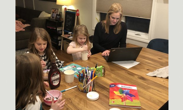 Jena Valdetero of Bryan Cave Leighton Paisner working from home with her daughters and a close family friend. (Courtesy photo)
