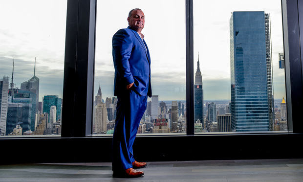 At Cooley's new offices at Hudson Yards, CEO Joe Conroy stands in his favorite place in the office, with a view of the Empire State Building behind him.(Photo by David Handschuh/NYLJ)