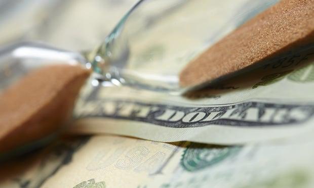 hourglass on dollars illustration