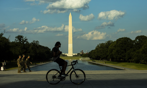 A man rides near the Washington Monument in Washington, D.C., on Saturday, June 6, 2020, amid nationwide protests over the death of George Floyd. (Photo: Diego M. Radzinschi/ALM)