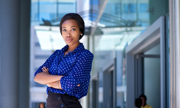 Young businesswoman standing outside office building