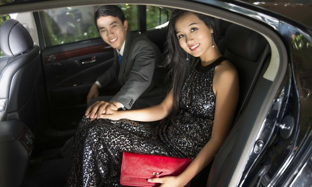 Portrait of a luxury young couple sitting in a car.