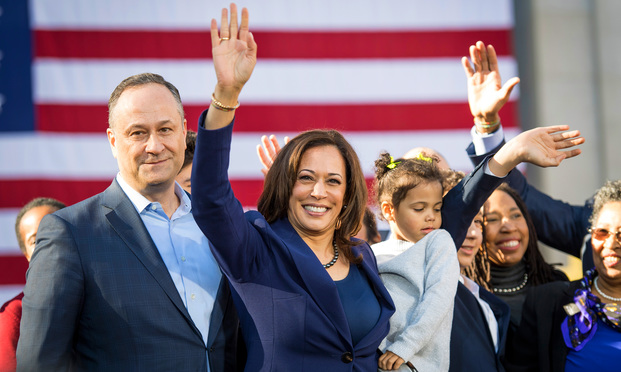 Senator Kamala Harris, a Democrat from California, holds her niece, Amara Ajagu, while standing with her husband, Doug Emhoff, left, during an event to launch presidential campaign in Oakland, California, U.S., on Sunday, Jan. 27, 2019. Harris's likely path to the Democratic nomination runs through black voters, who made up a quarter of the primary electorate in 2016 and were critical to nominating Hillary Clinton, as well as to electing Barack Obama in 2008 and 2012. Photographer: David Paul Morris/Bloomberg