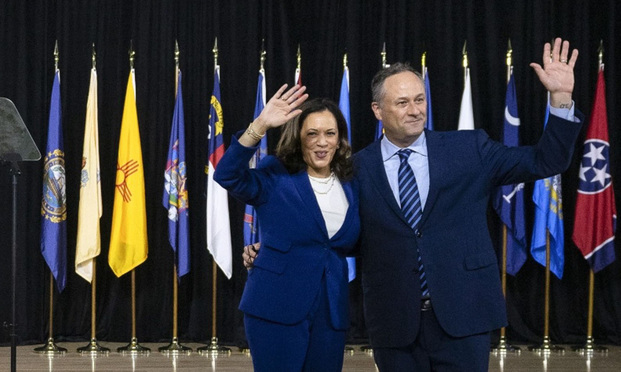 U.S. Sen. Kamala Harris, presumptive Democratic vice presidential nominee, and husband Douglas Emhoff, a partner at DLA Piper