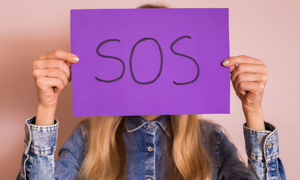 Woman holding up an SOS sign