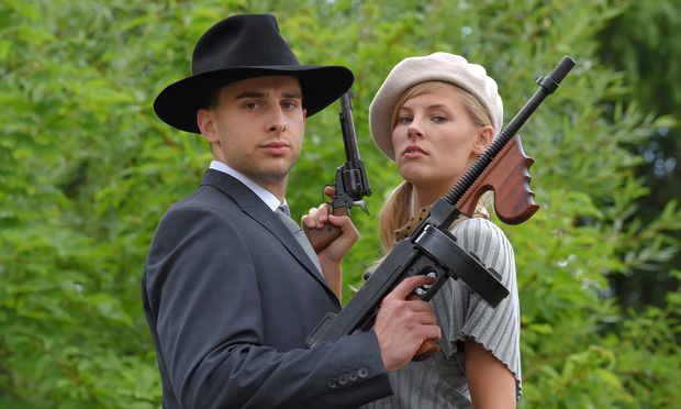 two people dressed up as Bonnie & Clyde