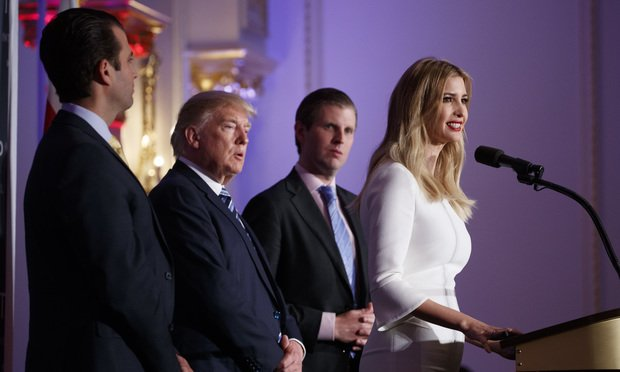 Donald Trump, flanked by his sons, Donald Trump Jr., left, and Eric Trump, and daughter Ivanka Trump. AP Photo/Evan Vucci