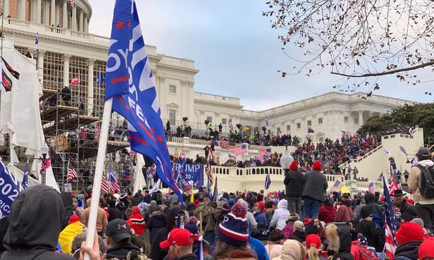 Trump supporters rioting at the US Capitol. Credit: Sebastian Portillo/Shutterstock.com