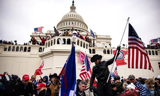Pro-Trump supporters storm the U.S. Capitol following a rally with President Donald Trump. Shutterstock.co