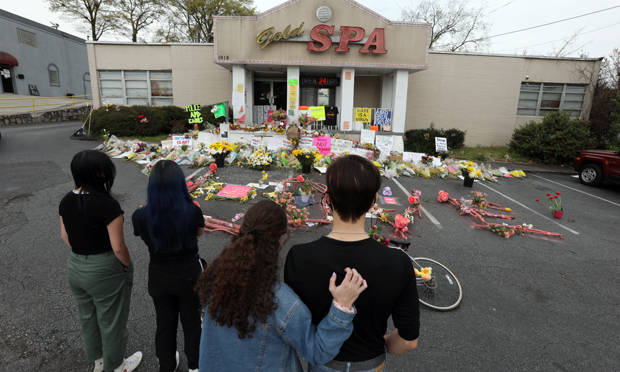 People pay their respects outside the Gold Spa on Piedmont Road in Atlanta Georgia on Wednesday, March 24, 2021. The Gold Spa, along with two other spas in Atlanta and Kennesaw, Georgia, were the scene of a mass shooting spree that claimed the lives of eight people. (Photo: John Disney/ALM)