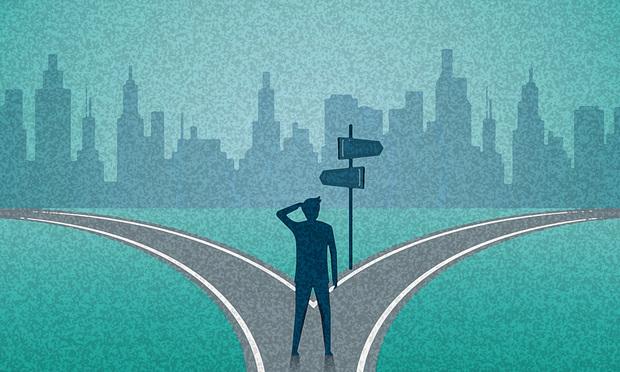 man at crossroads
