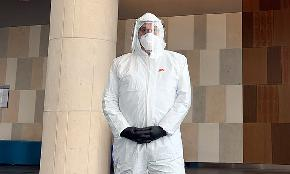 South Florida Lawyer Turns Heads by Wearing Full Hazmat Suit to Federal Court