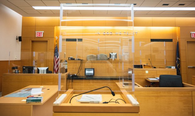A trial court room at the Kings County Supreme Court in Brooklyn. As in person cases are set to begin new procedures have been put in place to ensure the health and safety of everyone in the court room. This includes plexiglass dividing the judge'e bench, the witness stand, and the attorney's seats. The jurors are spread around the courtroom with clearly marked seating arrangements to ensure social distancing. There is a live webcam for the defendants friends and family to view the case from a safe distance in a separate room, and clear face masks and face shields are available to allow participants to show their facial expressions. Photo: Ryland West/ALM