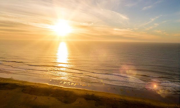 Image of the sunset taken over the Pacific Ocean by a drone flown from Golden Gate Park.