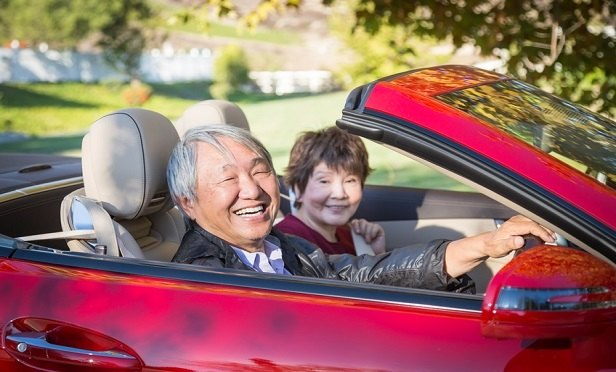 01_Retired-Asian-Couple-Driving_iStock.j