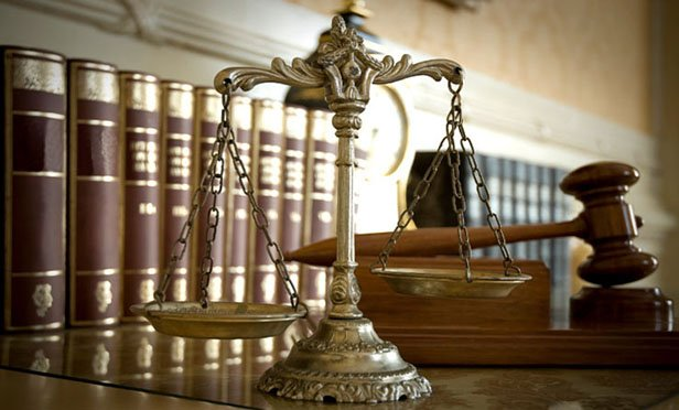 Law-books-with-scales-of-justice-and-gavel
