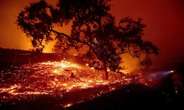 An intentional, multi-stepmitigation strategy is the single best way any organization, large or small, can protect their people and property from the catastrophic effects of wildfires.(AP Photo/Noah Berger)