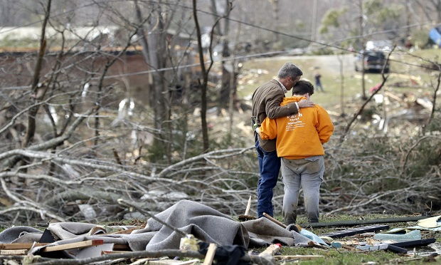 Tornadoes ripped across Tennessee early March. The storms shredded buildings and buried people in piles of rubble. (AP Photo/Mark Humphrey)