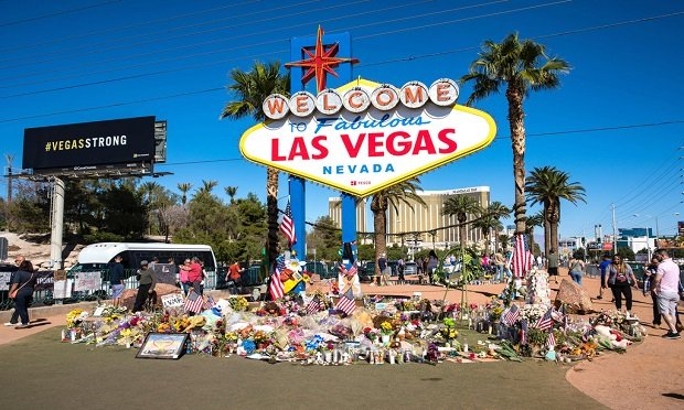 Flowers and gifts at the memorial park by Mandalay Bay on the Vegas Strip at the Las Vegas sign to remember victims killed in the Las Vegas mass shooting. (Photo: evenfh/Shutterstock)