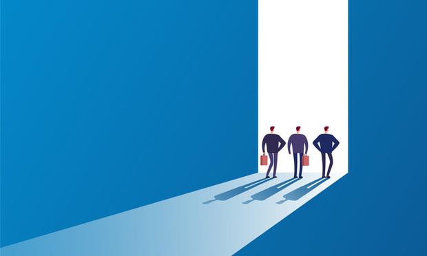 business opportunities/people walking through door - Credit: MicroOne/Shutterstock.com