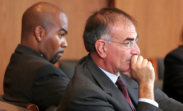 Lead plaintiff Ricky Brown, left, and attorney Scott Fein listen to witness testimony during an October 2005 civil rights trial in Albany.